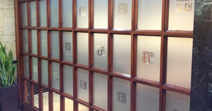 Etched frosted glass vinyl window graphics with the FirstBank logos for conference room privacy. 12-Point SignWorks - Franklin TN