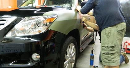 SUV matte wrap installation in progress. 12-Point SignWorks - Franklin TN