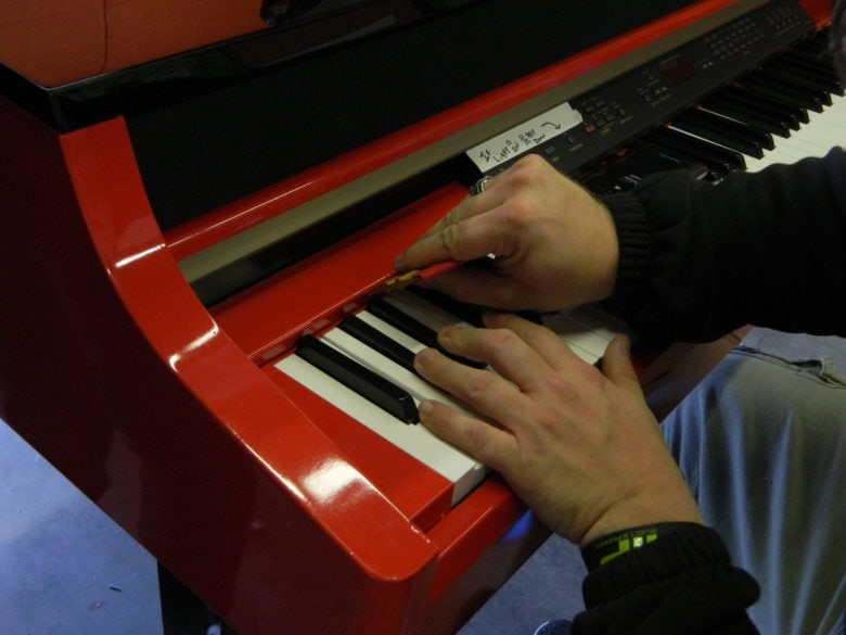 Our installer wrapping the detailed areas around the keyboard. 12-Point SignWorks - Franklin TN