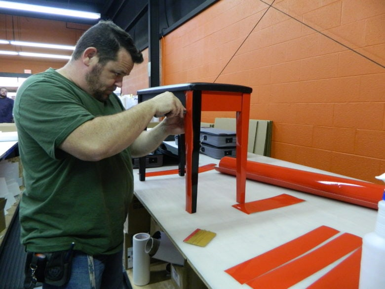 Our installer wrapping the stool for the Kelly Clarkson piano. 12-Point SignWorks - Franklin TN