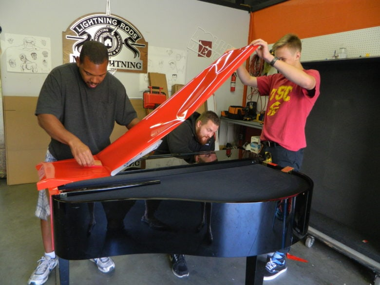 Our install team wrapping the piano for Kelly Clarkson. 12-Point SignWorks - Franklin TN