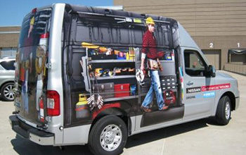 Nissan NV High Roof van with a custom advertising wrap. 12-Point SignWorks