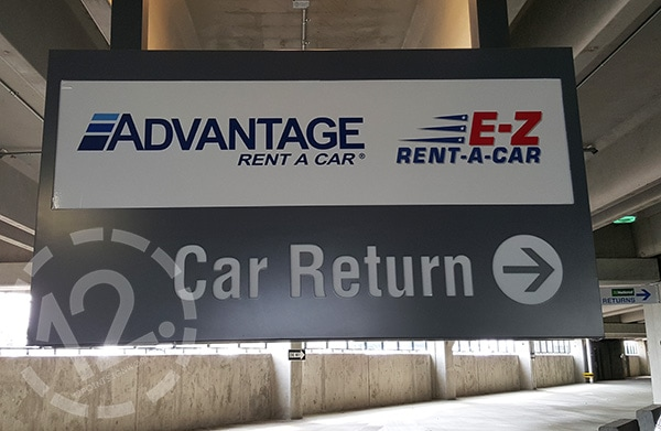 A Hanging Sign For Advantage Rent A Car At The Nashville Airport