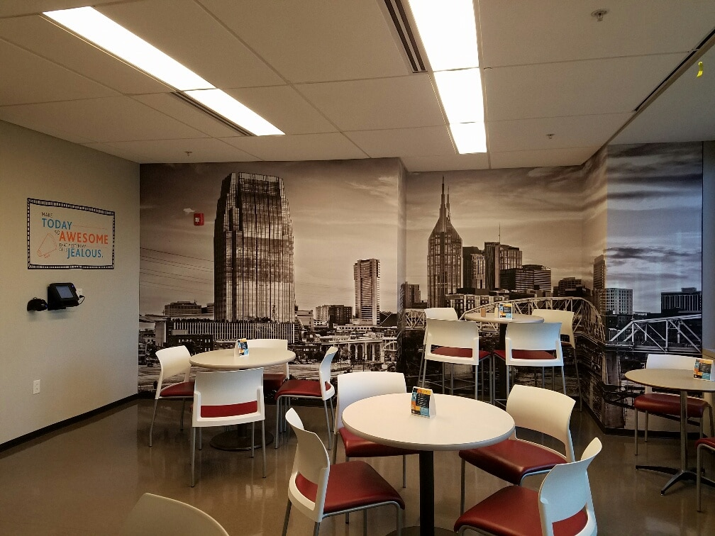 Environmental branding with wall murals and graphics for loews hotels 12 point signworks