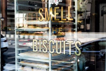 Custom window graphics for Biscuit Love in Nashville. 12-Point SignWorks - Franklin, TN