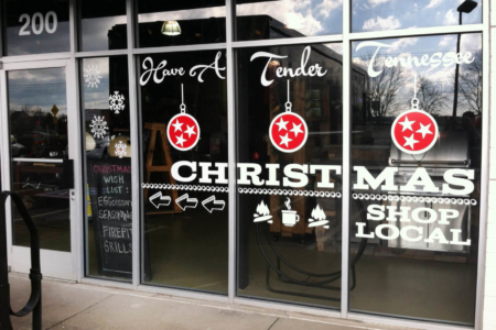 Holiday window graphics for Embers Grill & Fireplace Store in Brentwood. 12-Point SignWorks - Franklin, TN