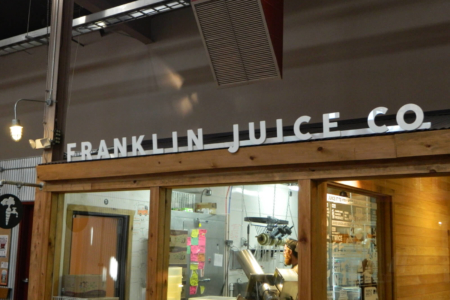 Acrylic Storefront Logo Sign for the Franklin Juice Company/ 12-Point SignWorks
