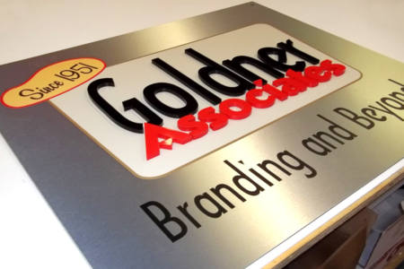 Brushed Metal & Acrylic Branded Graphics for Goldner Associates