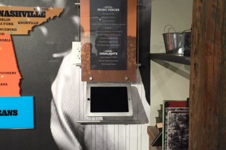Using a cable system to create an architectural display and iPad holder at the Franklin Welcome Center. 12-Point SignWorks - Franklin TN