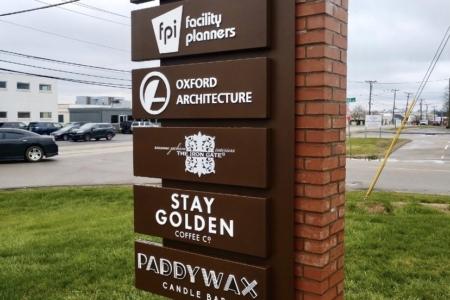 Custom Architectural Signage for the Oak Barrel Building in Nashville, TN, installed by 12-Point SignWorks