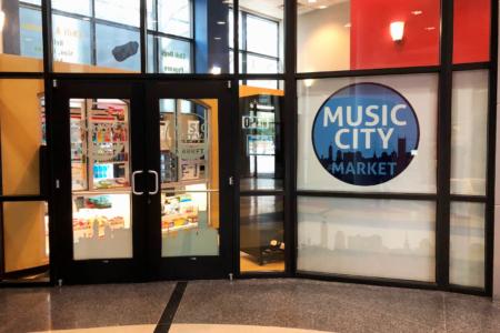 Custom designed window graphics for the Music City Market in Nashville. 12-Point SignWorks - Franklin, TN
