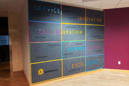 Custom Service Wall Display for NewGround in St. Louis, MO/  fabricated & installed by 12-Point SignWorks