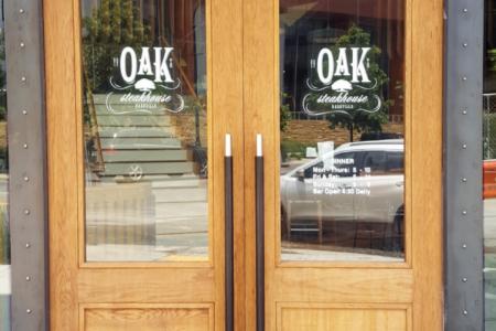 Window vinyl for the Oak Steakhouse by 12-Point SignWorks in Franklin, TN.