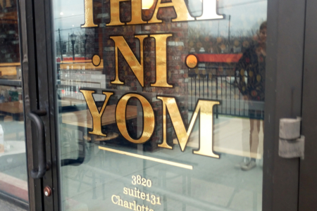 Custom Window Graphics for Thai Ni Yom Restaurant in Nashville, TN by 12-Point SignWorks.