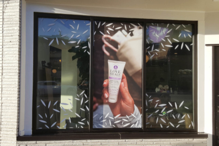 Holiday window graphics for Thistle Farms in Nashville. 12-Point SignWorks - Franklin, TN