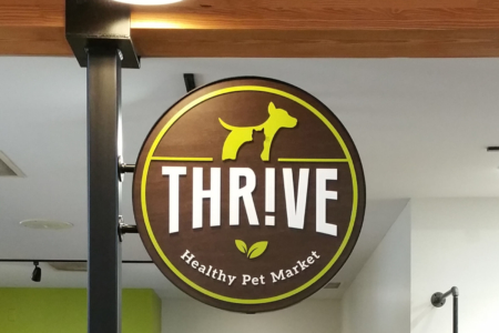 Hanging Dimensional Logo for Thrive Healthy Pet Market in Franklin, TN