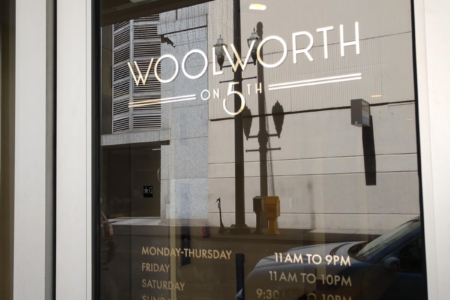 Cut vinyl window graphics for Woolworth on 5th, Nashville installed by 12-Point SignWorks.