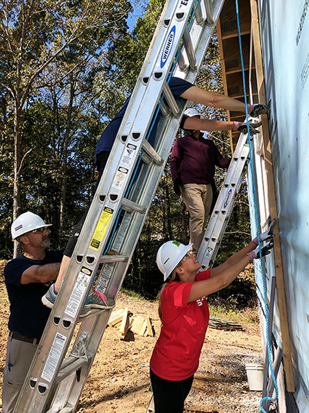 Nissan North America volunteers work together to build a Habitat for Humanity home. 12-Point SignWorks - Franklin, TN