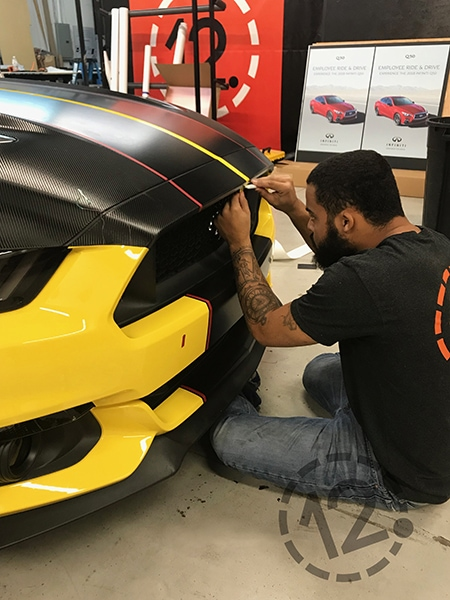 This photo shows the careful detail work we do when applying a stripe kit to a vehicle. 12-Point SignWorks - Franklin, TN