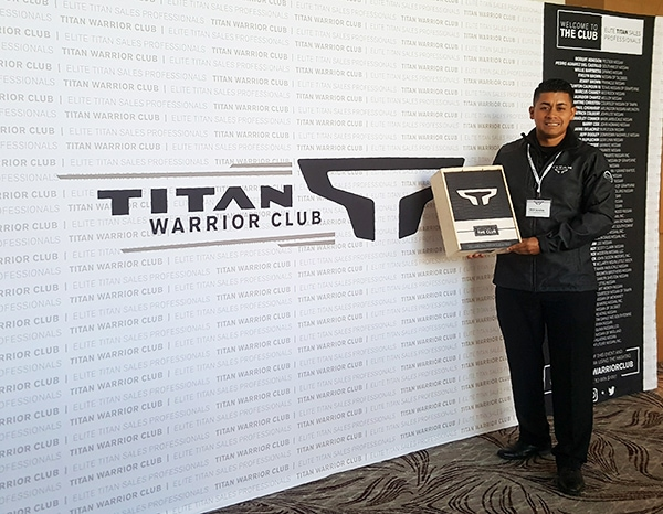 This award-winning sales professional is standing in front of the new Nissan TITAN Warrior pop-up display. 12-Point SignWorks - Franklin, TN