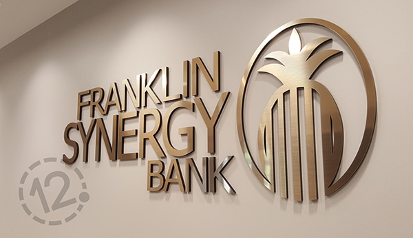 Brushed gold Rowmark and black acrylic were used to create this dimensional sign. 12-Point SignWorks - Franklin, TN