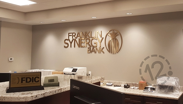The dimensional logo sign adds a touch of class to the teller work area. 12-Point SignWorks - Franklin, TN