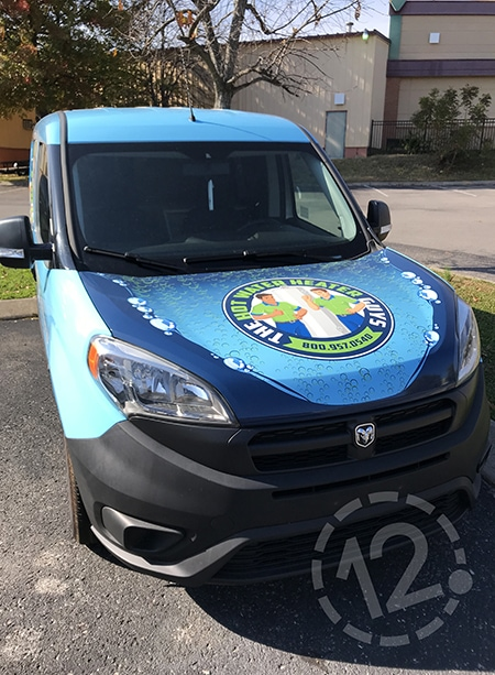 Our designer incorporated The Water Heater Guys' logo into the custom vehicle wrap design. 12-Point SignWorks - Franklin, TN