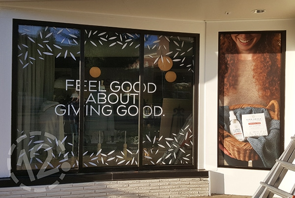 Thistle Farms used their windows to communicate their philanthropic mission. 12-Point SignWorks - Franklin, TN
