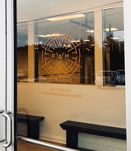 This new copper window decal was installed first surface on the gym's front door for their rebranding. 12-Point SignWorks - Franklin, TN