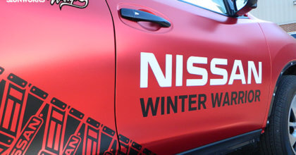 A glimpse of the snow track pattern and the Nissan and Winter Warrior logos on the Nissan Rogue. 12-Point SignWorks