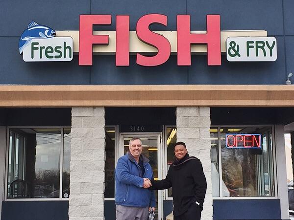 Striking food truck wrap helps fresh fish fry support for Fresh fish lansing mi