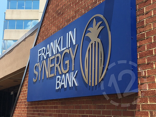 Franklin Synergy Bank halo lit sign during the day. 12-Point SignWorks - Franklin, TN