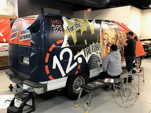 Installation of a vinyl wrap. 12-Point SignWorks - Franklin, TN