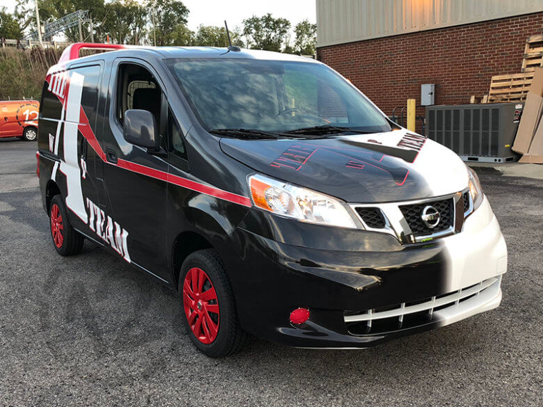 a team van wrap brings on the nostalgia at nissan dealer. Black Bedroom Furniture Sets. Home Design Ideas