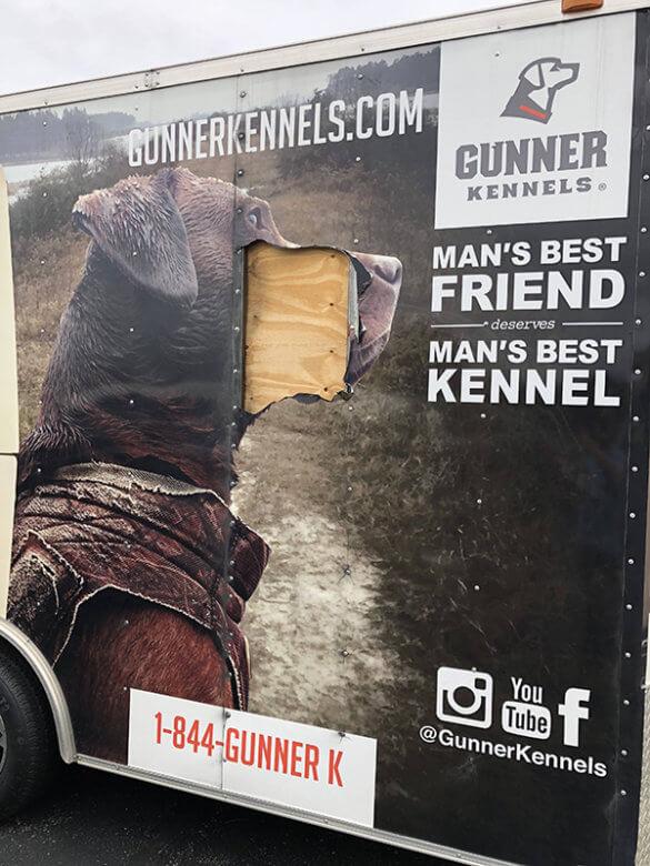 Damage to Gunner Kennels' Trailer Wrap. 12-Point SignWorks - Franklin, TN