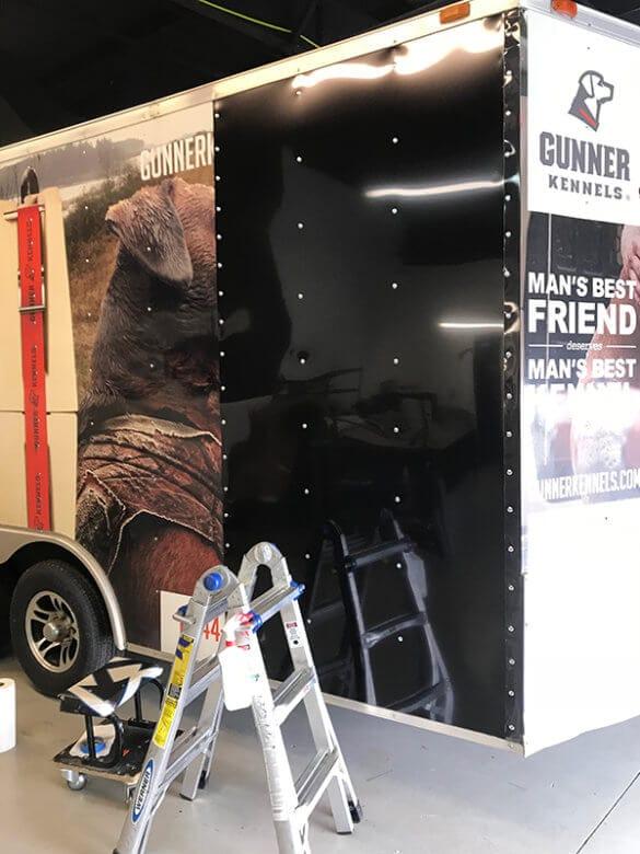 Gunner Kennel Trailer Wrap Before Vinyl Repair. 12-Point SignWorks - Franklin, TN