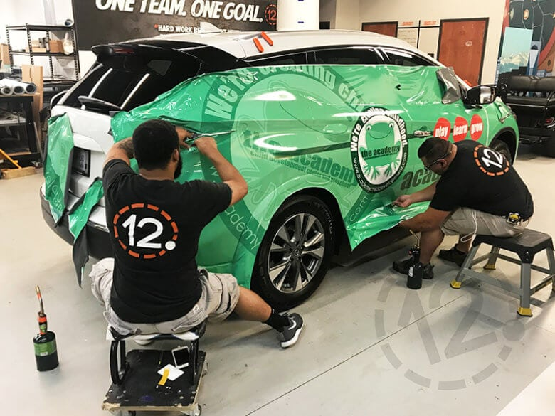 Vehicle wrap installation at 12-Point SignWorks in Franklin, TN.