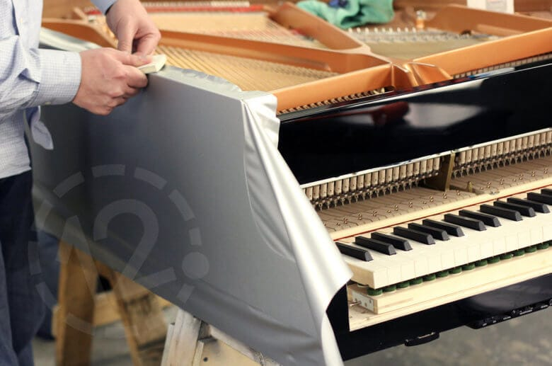 Installation of piano wrap by 12-Point SignWorks in Franklin, TN.