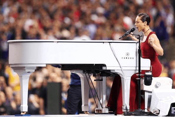 Piano wrap for Alicia Keys' Super Bowl performance by 12-Point SignWorks in Franklin, TN.