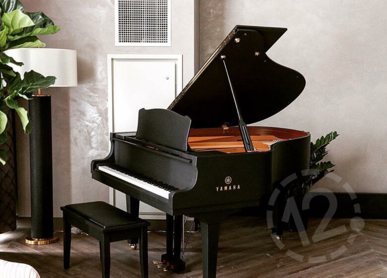 Matte black piano wrap for the Hutton Hotel in Nashville, TN by 12-Point SignWorks.