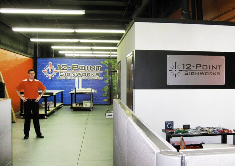 Owner Murray Johns at 12-Point SignWorks when it opened in 2009.