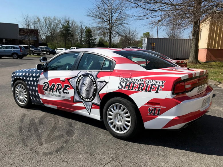 Custom patriotic car wrap for the Robertson County Sheriff's Office by 12-Point SignWorks in Franklin, TN.
