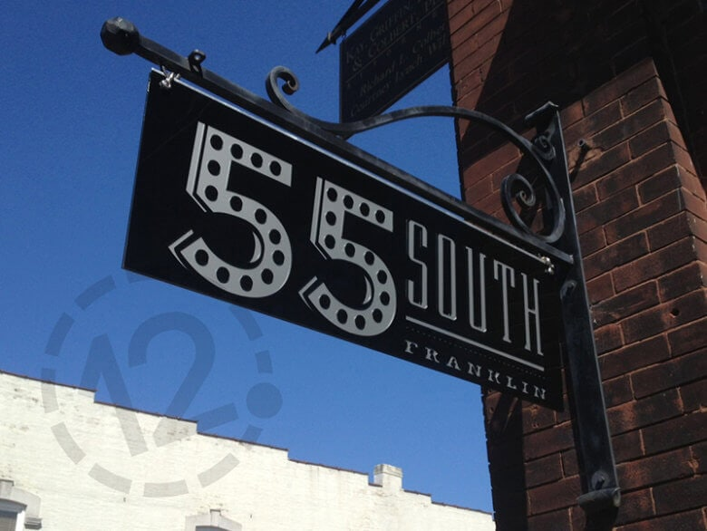 Custom hanging bracket sign for 55 South by 12-Point SignWorks in Franklin, TN.