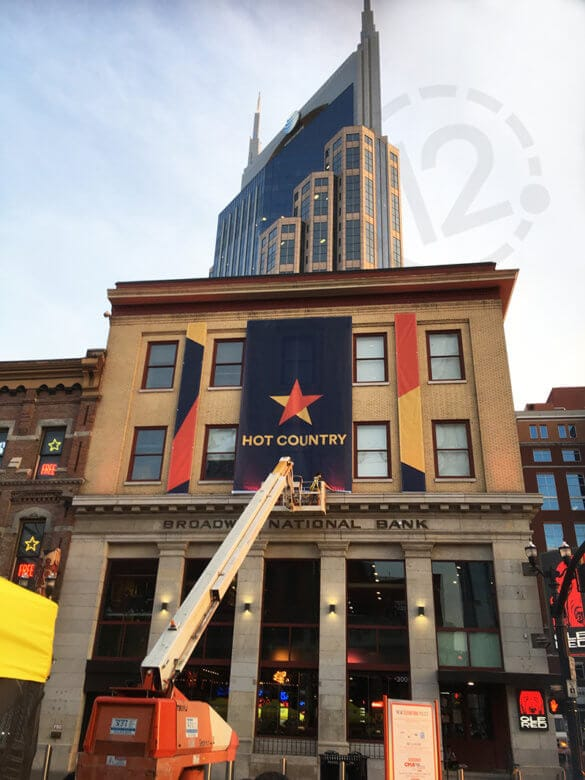 Banner installation at Ole Red Restaurant and Music Venue in Nashville, TN by 12-Point SignWorks.