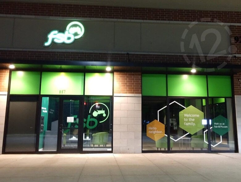 Window graphics for Farmers State Bank fabricated and installed by 12-Point SignWorks.