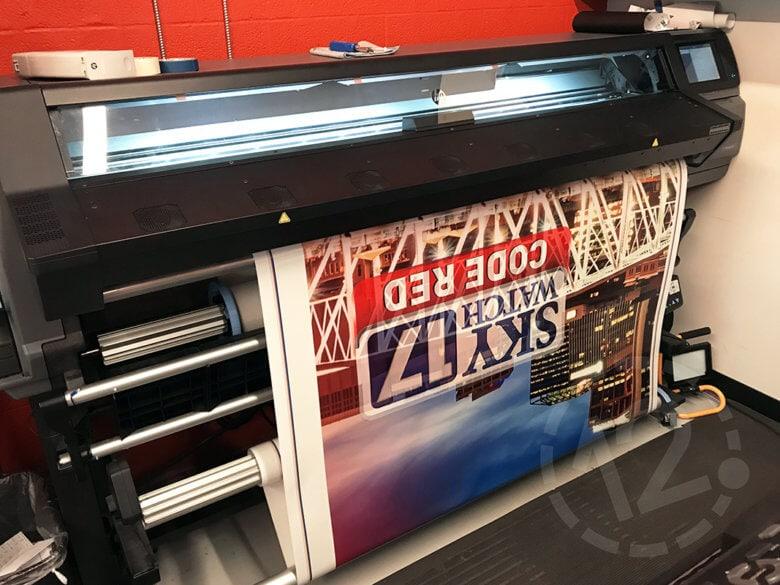 Printing WZTV Fox 17's custom van wrap at 12-Point SignWorks in Franklin, TN.