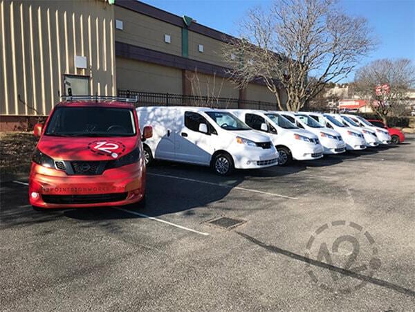 Leased Nissan NV vans prior to vinyl wrap installation. 12-Point SignWorks in Franklin, TN