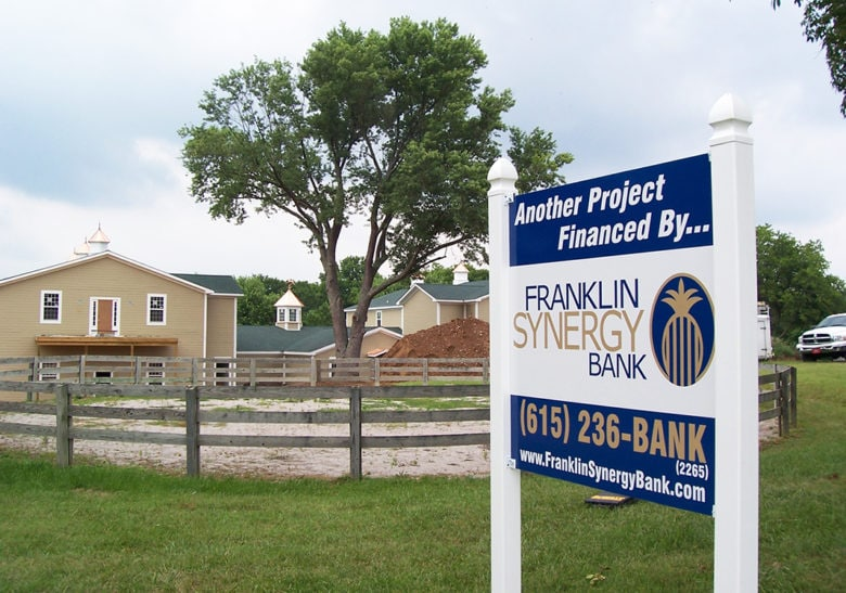 Post and panel sign for Franklin Synergy Bank by 12-Point SignWorks in Franklin, TN.