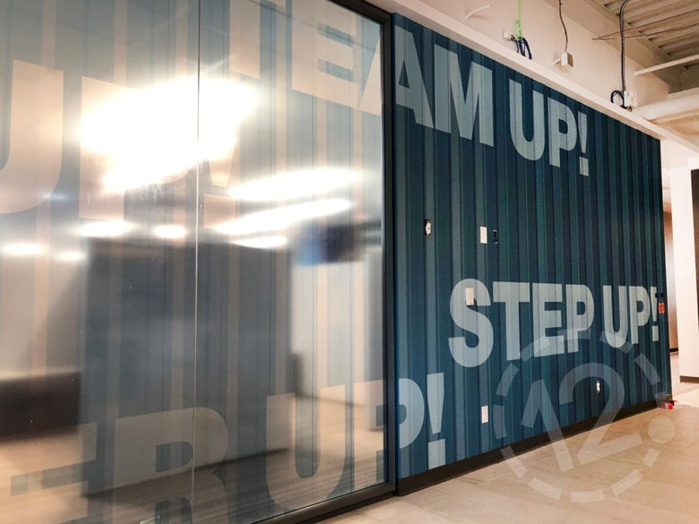 Window vinyl and wall graphics for SFPCU in San Bruno, CA fabricated and installed by 12-Point SignWorks.