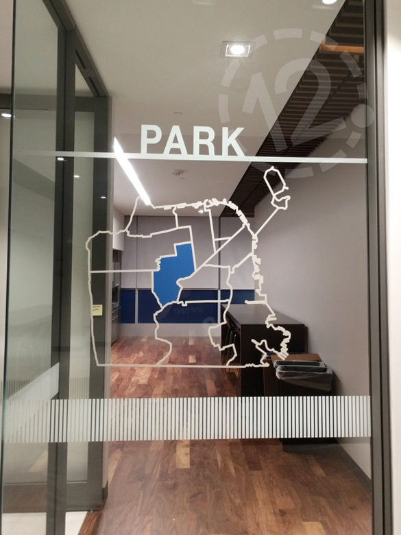 Vinyl window graphics for SFPCU fabricated and installed by 12-Point SignWorks.